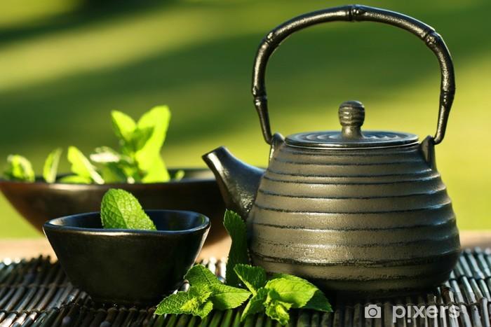Pixerstick Sticker Zwarte ijzeren Aziatische theepot met takjes munt voor de thee -