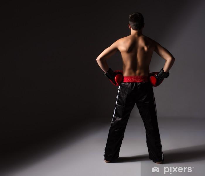Naklejka Pixerstick Młody mężczyzna kickboxer - Tematy
