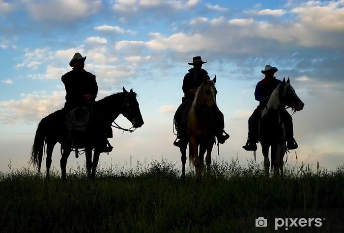Mural de Parede em Vinil Cowboys on horseback at first light. Silhouettes - Homens