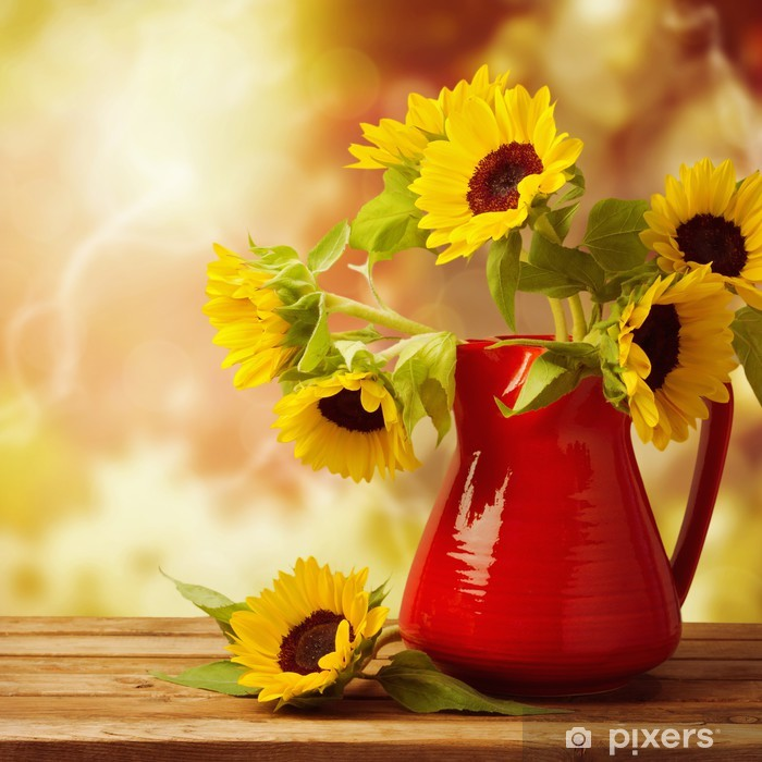Sunflower bouquet in jug on wooden table over autumn bokeh Framed Poster - Styles