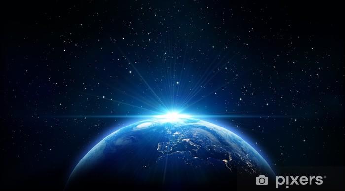 Naklejka Pixerstick Niebieski wschód słońca, widok Ziemi z przestrzeni kosmicznej - Wszechświat