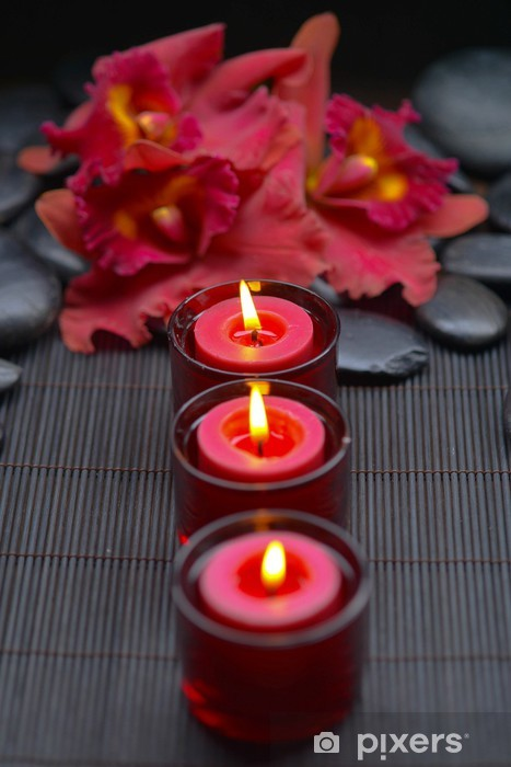 red orchid with row of candle and zen stones on mat Vinyl Wall Mural - Lifestyle>Body Care and Beauty