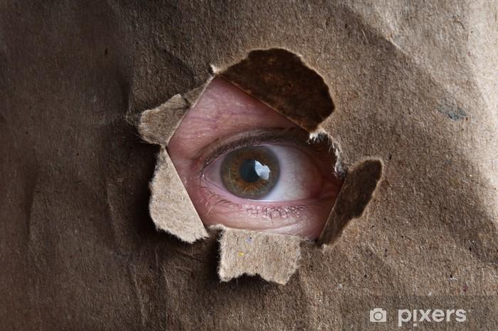 Naklejka Pixerstick Ludzkie oko patrząc przez otwór tektury - Części ciała