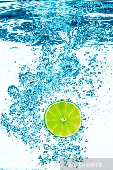 Green lime in the Water. Pixerstick Sticker - Fruit