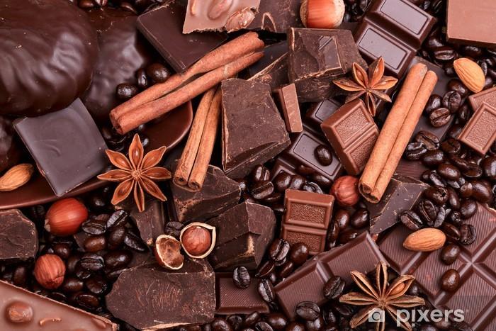 Vinyl Fotobehang Achtergrond van segmenten van chocolade, koffie, noten en specerijen - Thema's