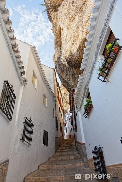 Papier peint vinyle Vue de la rue entre les rochers dans Setenil de las Bodegas, Espagne - Paysages urbains