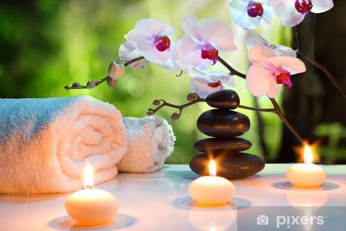Fototapeta winylowa Masaż skład spa z świece, orchidee, kamienie w ogrodzie - Przeznaczenia