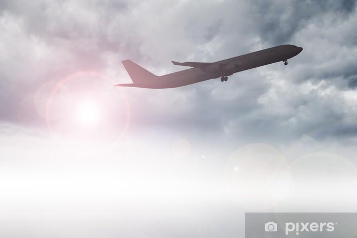 Fototapeta winylowa Samolot lecący nad chmurami - Transport powietrzny
