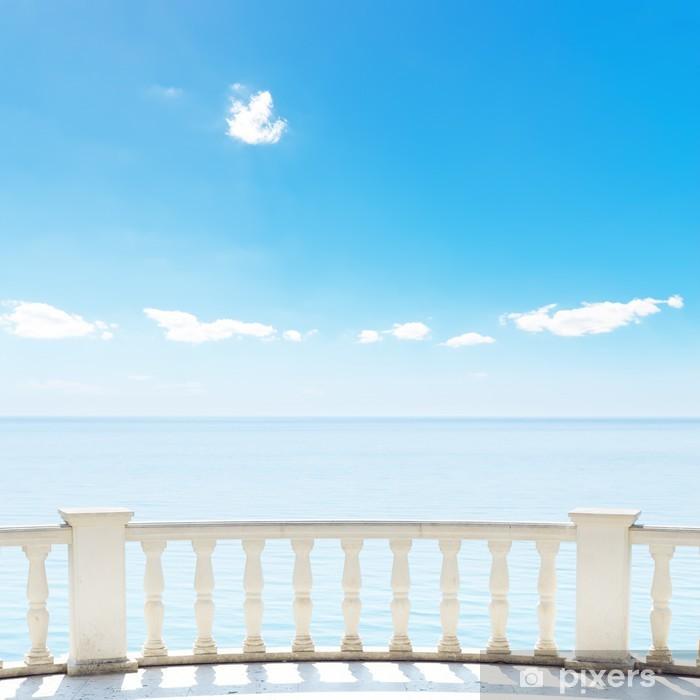 Fototapeta winylowa Białe balkon na tarasie w pobliżu morza i błękitnego nieba - Przemysł ciężki