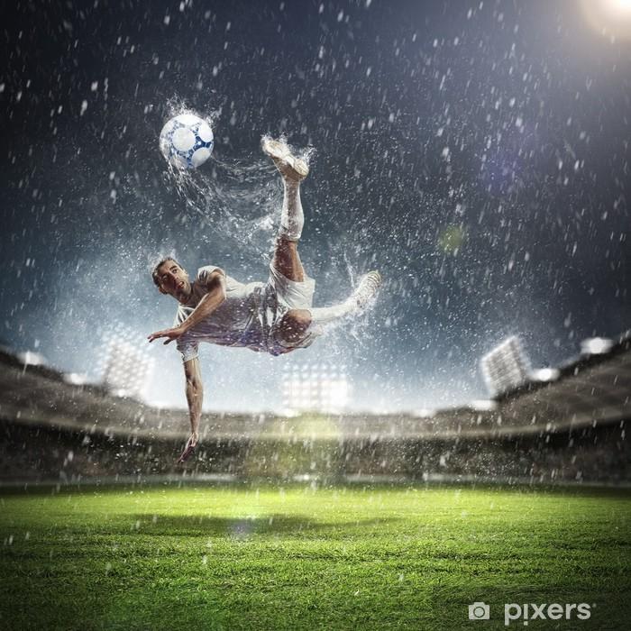 Fototapeta winylowa Piłkarz uderzając piłkę - Tematy