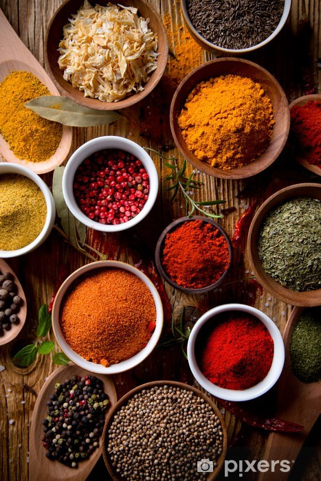 Assorted spices on wooden background Vinyl Wall Mural - Themes