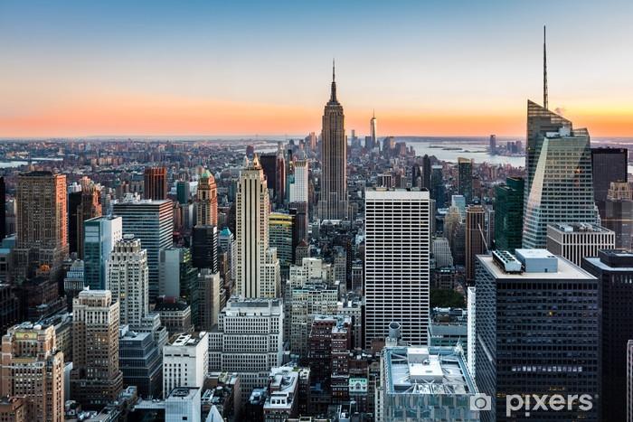Afwasbaar Fotobehang De horizon van New York bij zonsondergang -