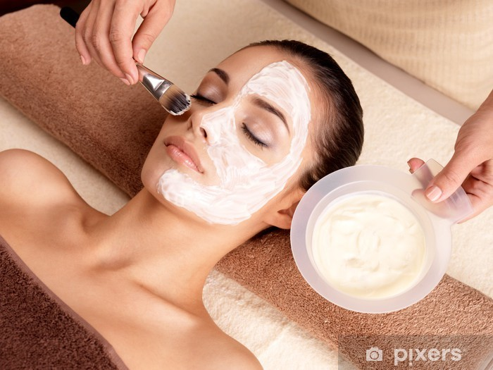 Spa therapy for woman receiving facial mask Pixerstick Sticker - Lifestyle>Body Care and Beauty