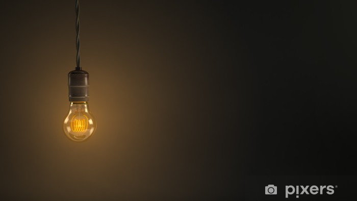 Vintage Hanging Light Bulb Over Dark