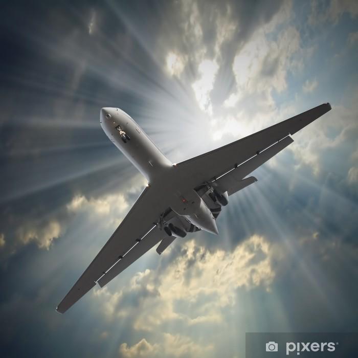 Papier peint vinyle Avion de passagers de Jet voler contre le ciel orageux. - Thèmes