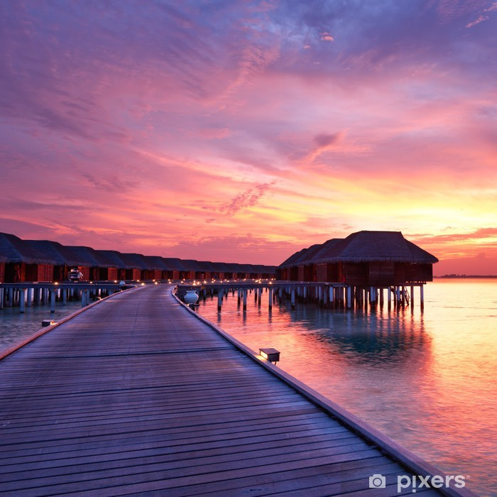 Fototapeta winylowa Zachód słońca na plaży Malediwach - Tematy