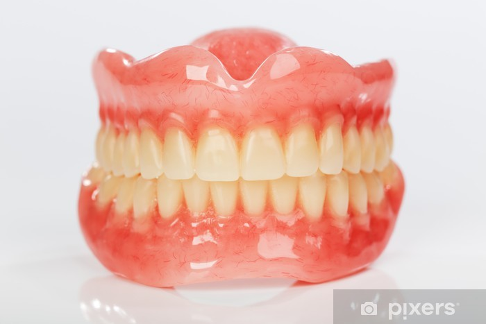 A set of dentures on a shiny white background Vinyl Wall Mural - Health and Medicine
