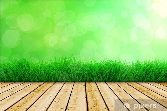 Fotobehang achtergrond met verse groene gras en houten vloer