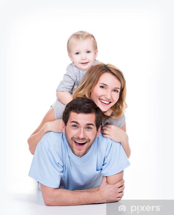 Naklejka Pixerstick Uśmiechnięta młoda rodzina z małym dzieckiem. - Wartości rodzinne