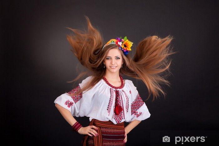 Portrait of a beautiful girl with flying brown hair. Woman wears Pixerstick Sticker - Women