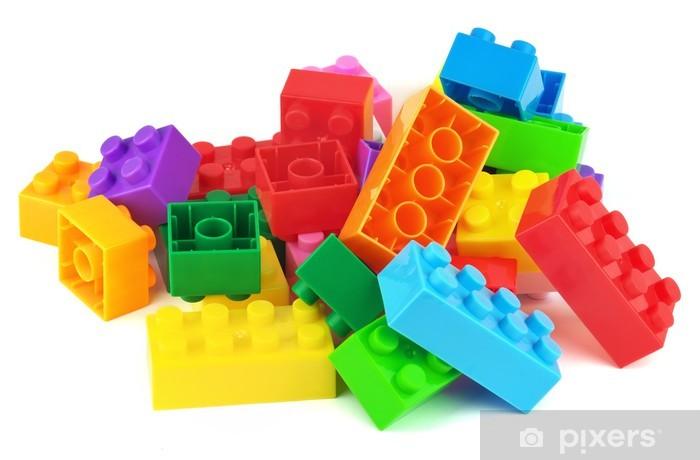 Fototapeta winylowa Bloki kolorowe plastikowe zabawki samodzielnie na białym tle - Gry