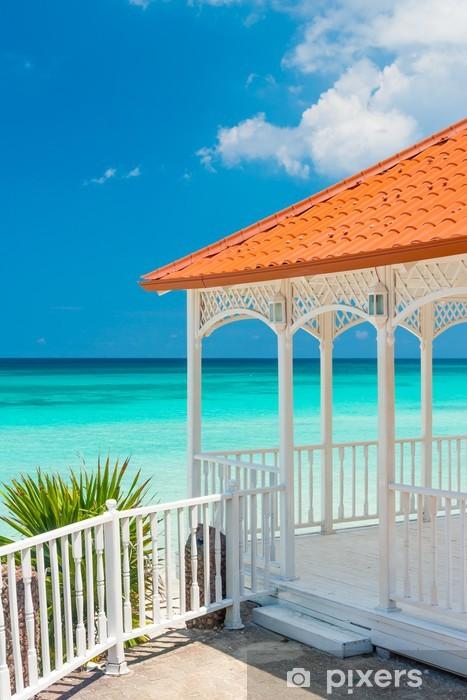 Beautiful wooden terrace next to a beach in Cuba Vinyl Wall Mural - Themes