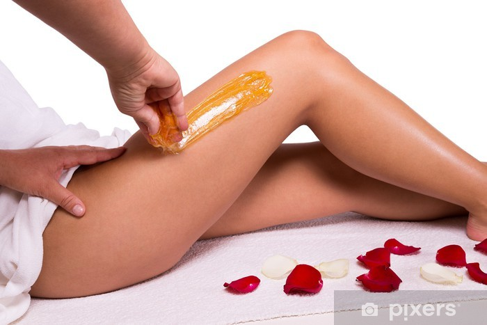 Sugaring: epilation with liquate sugar at legs. Vinyl Wall Mural - Lifestyle>Body Care and Beauty
