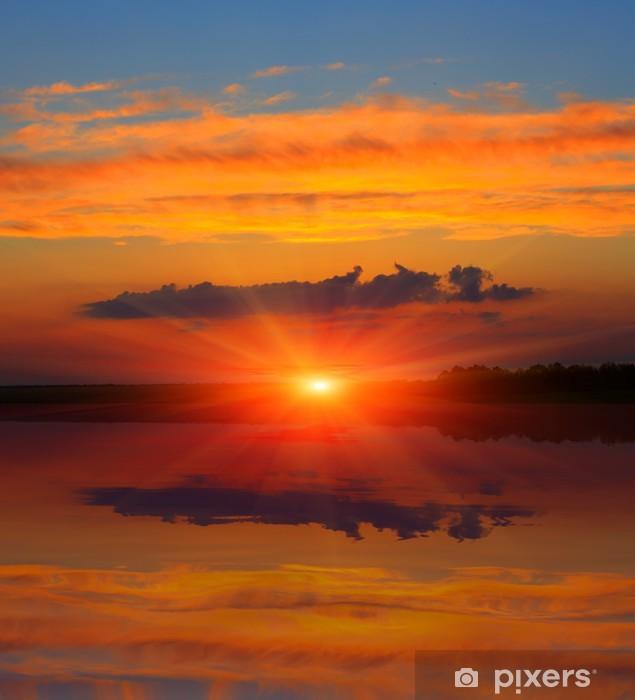 Papier peint vinyle Ciel coucher de soleil sur le lac - Saisons