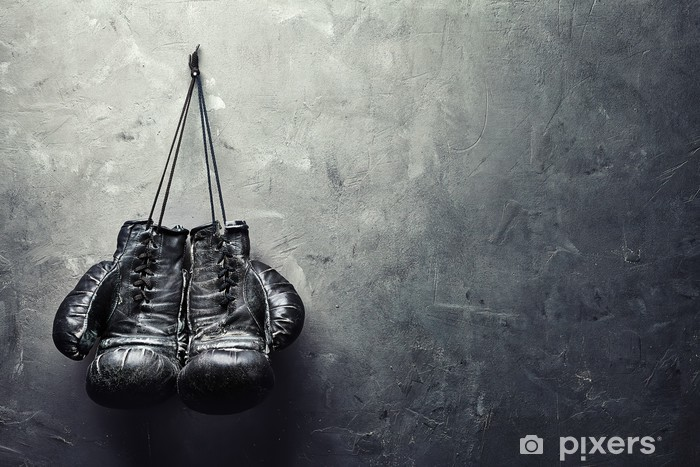 old boxing gloves hang on nail on texture wall Vinyl Wall Mural - Lifestyle