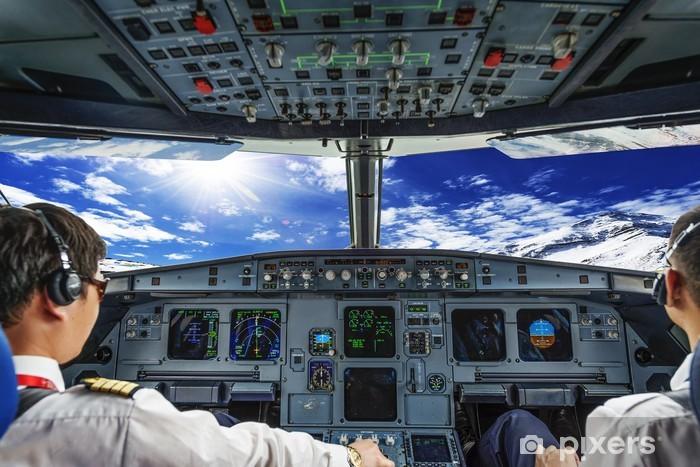 Fototapeta winylowa Piloci w kokpicie samolotu - Transport powietrzny