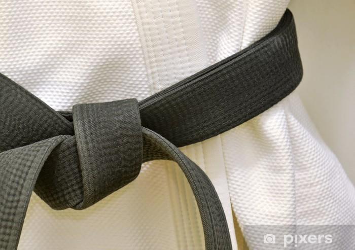 Fototapet av Vinyl Karate svart bälte på vit uniform - Taekwondo