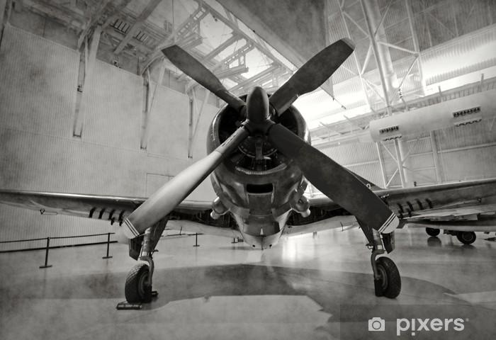 Old airplane in a hangar Pixerstick Sticker -