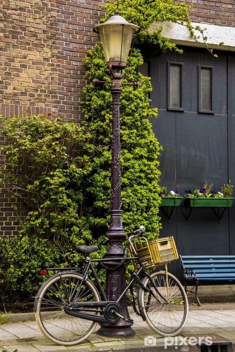 Bicycle tied on a light pole in Amsterdam Vinyl Wall Mural - European Cities