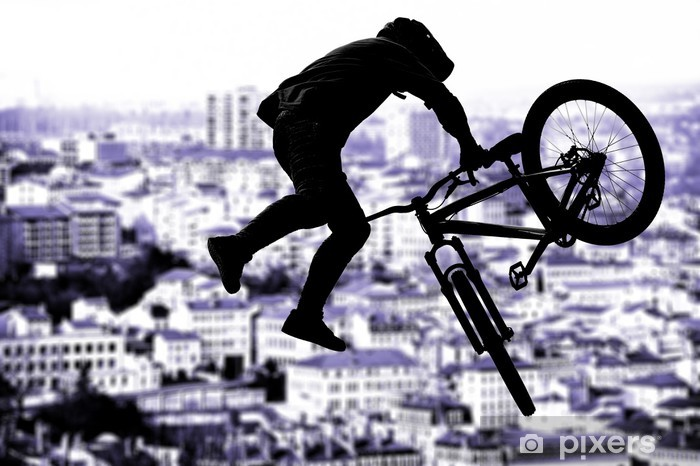 Fototapeta winylowa Bmx rider sylwetka sportu w dzia scenerii tle - Kolarstwo