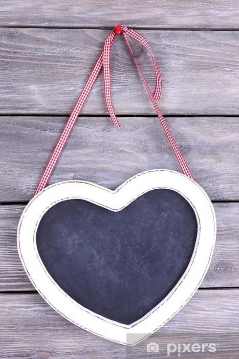 Fototapeta winylowa Tablica w kształcie serca na tle drewniane - Znaki i symbole