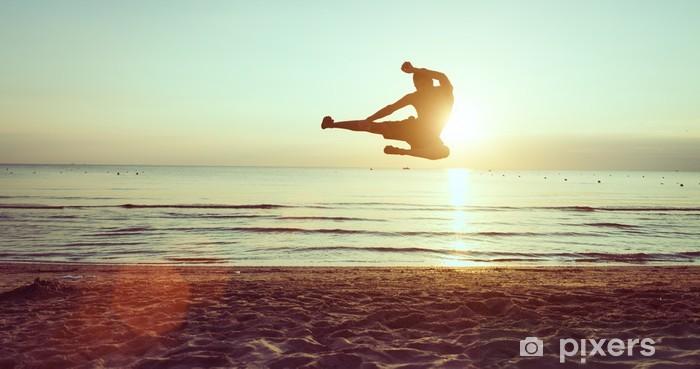 flying kick on the beach Pixerstick Sticker - Themes