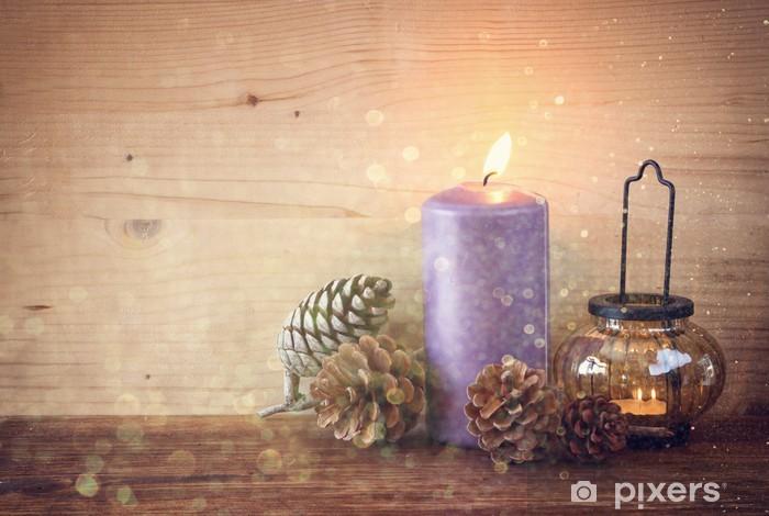 Fototapeta winylowa Rocznik Latarnia z płonących świec, szyszki na drewnianym stole - Święta międzynarodowe