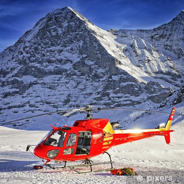 Plakat Czerwony śmigłowiec wylądował w pobliżu alpejskiego szczytu koło góry Jungfrau - Europa