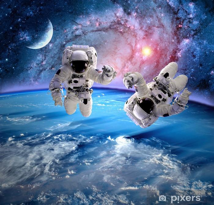 Papier peint vinyle Astronaut Spaceman Planète Lune - Au travail