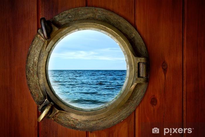Fototapeta winylowa Close-up z łodzi zamknięte iluminator z widokiem na ocean - Transport wodny
