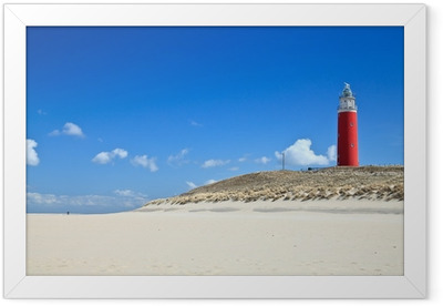 Lighthouse in the dunes at the beach Framed Poster