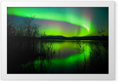 Northern lights mirrored on lake Framed Poster