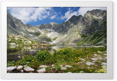 Mountain lake in background with high mountain Framed Poster