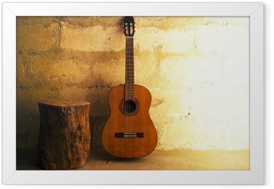Acoustic guitar on old wall - copyspace Framed Poster