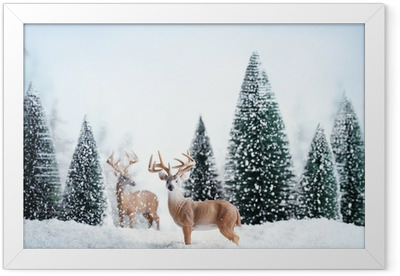 Winter landscape with deers,snow and fir tree. Framed Poster