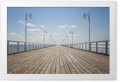 Old empty wooden pier over the sea shore with copy space Framed Poster