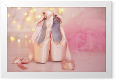 Ballet pointe shoes on floor on bokeh background Framed Poster