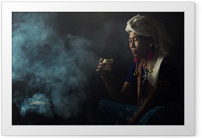 Tribal women are smelling scents aromatic coffee. She planted herself Framed Poster