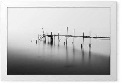 A Long Exposure of an ruined Pier in the Middle of the Sea.Processed in B&W. Framed Poster