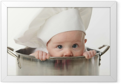 Close up of baby sitting in stock pot Framed Poster